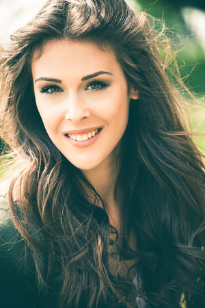 outdoor shot: beautiful young woman smiling portrait , outdoor shot