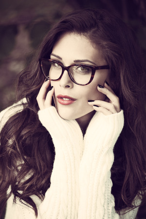 eyeglasses: young urban fashion woman wearing eyeglasses outdoor shot in the city