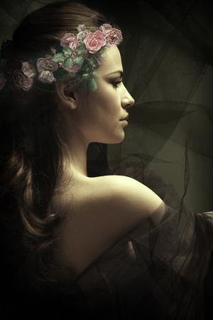 young sensual brunette woman with wreath of roses in hair composite photo, profile