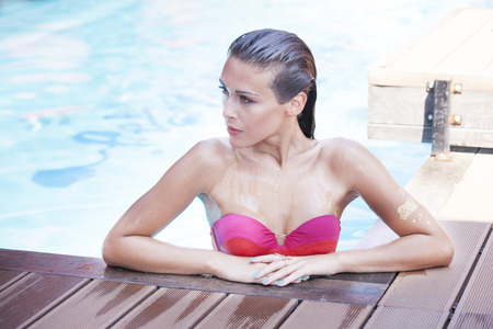 sexy brunette woman: young beautifull girl at the swwimming pool