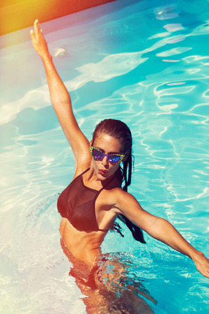 sexy fashion: young attractive woman have a fun in pool Stock Photo