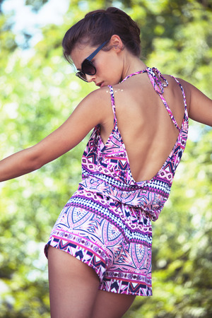 jumpsuit: beautiful young woman in summer short jumpsuit and sunglasses outdoor shot