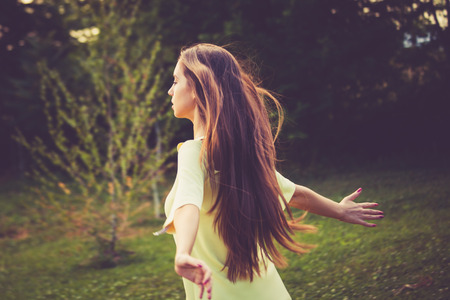 young woman enjoy in summer wind in nature