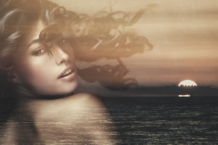 woman sunset: beautiful exotic tanned woman with long wavy hair in motion double exposure with sea sunset