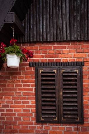 balk: wooden window and pots with flowers on a mountain house Stock Photo
