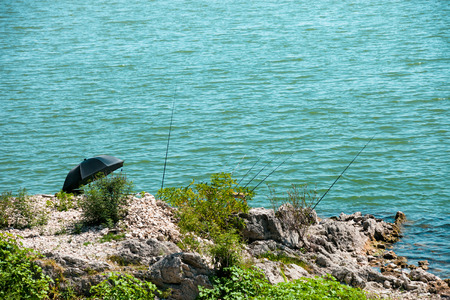 sorted: fishing rod sorted on the lake coast summer day Stock Photo