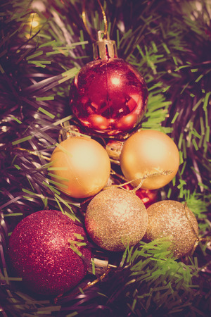greenness: background christmas decoration, small red and golden balls  and greenness strips, retro colors Stock Photo