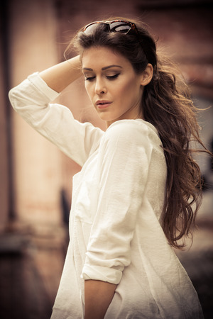 woman white shirt: young beautiful long hair woman portrait, outdoors in the city, wearing white shirt, autumn day
