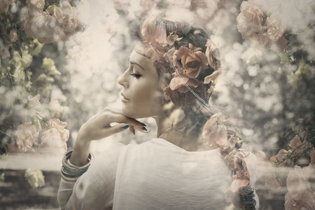 fantasy beautiful young woman like fairy, double exposure with roses, small amount of grain added