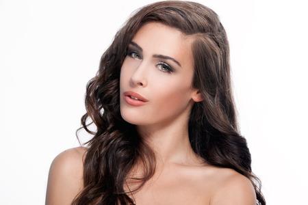green eyes: young brunette green eyes woman beauty portrait, studio shot