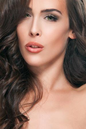 light complexion: young brunette green eyes woman beauty portrait, studio shot