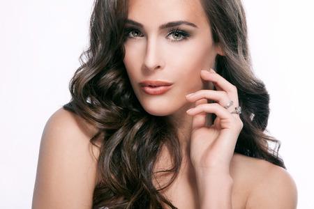 beauty woman: young brunette green eyes woman beauty portrait, studio shot