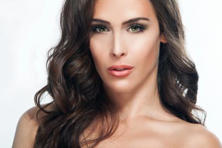 brown eyes: young brunette green eyes woman beauty portrait, studio shot