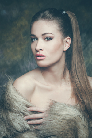 perfect face: beautiful young sensual woman with artificial fur  portrait, studio shot, front view