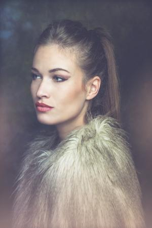 fur: beautiful young sensual woman with artificial fur  portrait, studio shot