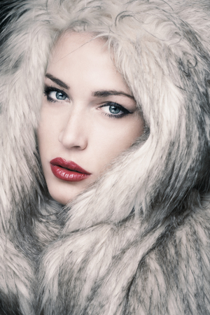 sensual woman: beautiful blue eyes young woman with artificial fur portrait in studio