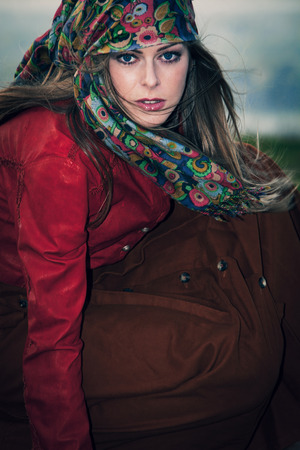 gypsy woman: young blue eyes blonde woman in gypsy style fashion, outdoor windy day Stock Photo