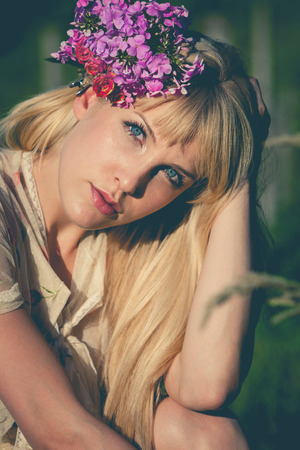 enjoy in fields of summer with flowers in hair, blonde girl portrait photo