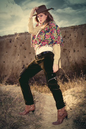 full shot: cowgirl style fashion young woman, outdoor day shot, full body shot