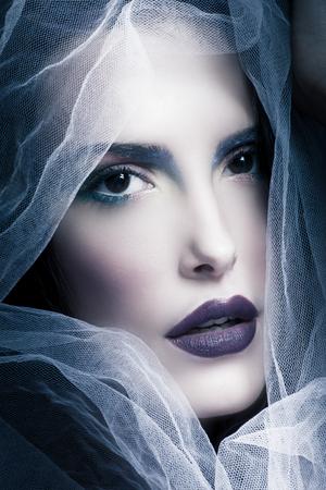 mystical woman: mystical woman beauty portrait with veil, studio shot, closeup