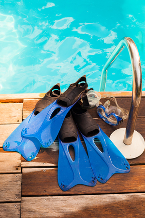 fins: a pair of fins and mask for diving on the edge of the pool, from above