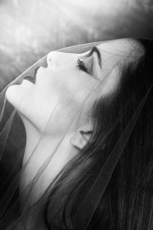 mystical: woman under veil portrait black and white closeup