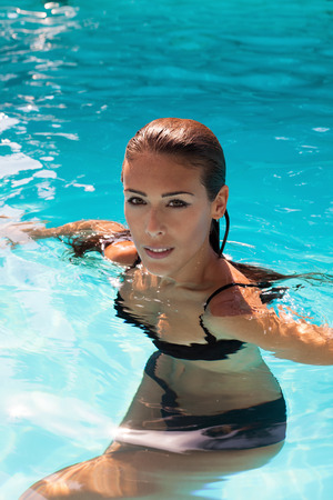 fresh water: young woman enjoy in outdoor pool, summer day, natural light