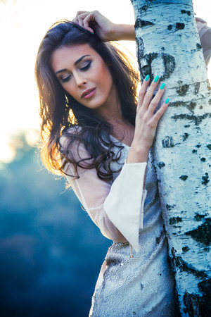 natural light: elegant young woman in white dress outdoor shot winter day
