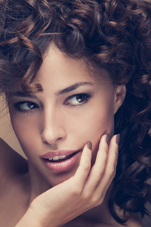 hair and beauty: curly hair beauty woman portrait, studio shot, closeup