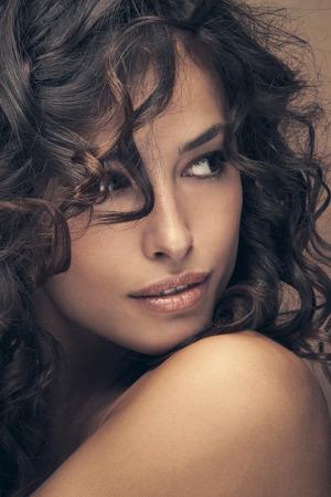 curly: curly hair beauty woman portrait, studio shot, closeup