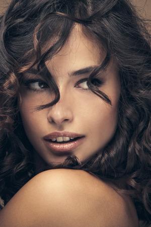 look latino: curly hair beauty woman portrait, studio shot, closeup