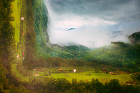 photo manipulation: small village in rainy mountain, bend photo manipulation