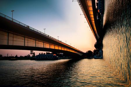 inception: Belgrade bridge over river Sava at sunset, bend photo manipulation