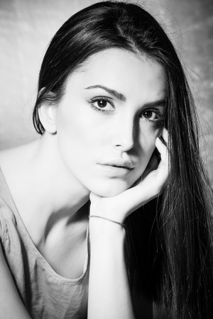lean on hands: young woman portrait in black and white