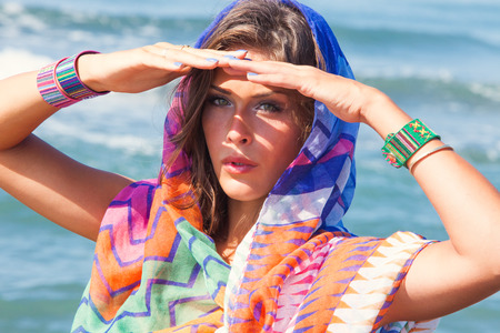 tanned young beach fashion woman portrait with  colorful sarong and bracelets  at sea beach sunny summer day Stock Photo