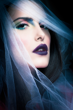 mysterious woman: young mysterious woman portrait with white veil