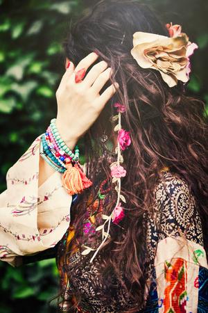 outdoor shot: woman boho style hair fashion details closeup outdoor shot