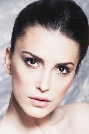 slicked: young woman beauty portrait with natural look makeup studio shot