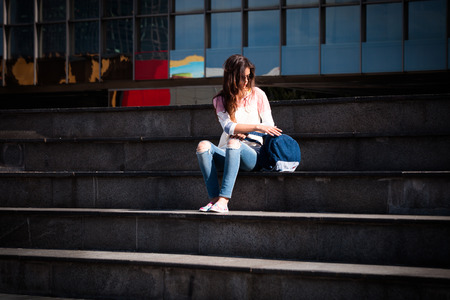 brak: young woman student take break at stairs outdoor at city Stock Photo