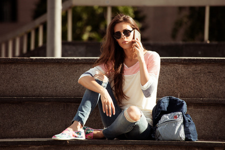 brak: young woman student take break at stairs outdoor at city use smartphone