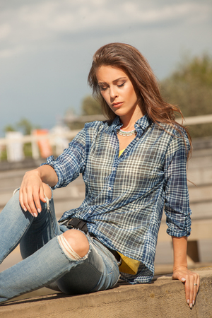 blue shirt: urban young woman portrait in blue jeans and shirt