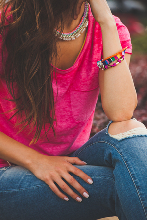 women in jeans: young urban woman with colorful summer bracelets Stock Photo