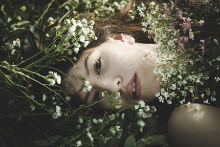 natural beauty: young woman portrait in flowers outdoor shot summer day