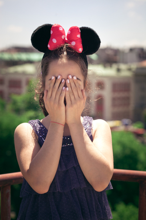 minnie mouse: teen girl portrait with minnie mouse ears outdoor at building  terrace summer day Stock Photo
