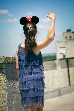 minnie mouse: teen girl  with minnie mouse ears outdoor at roof terrace like a super hero summer day