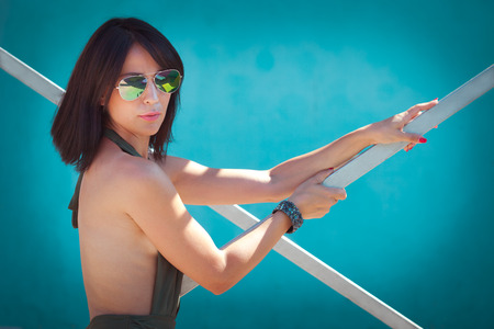 swimsuite: young woman with sunglasses and swimsuite portrait outdoor sunny summer day Stock Photo