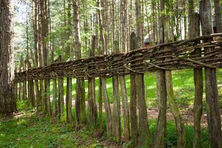 wooden fence: old woven wooden fence in wood