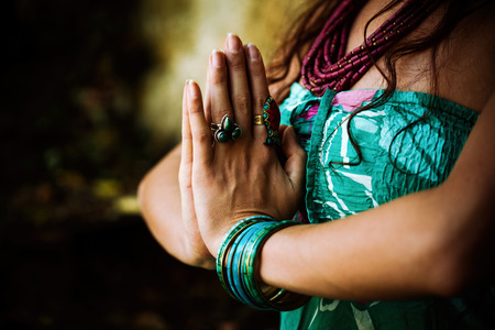 woman chest: woman practice yoga outdoor close up of hands in namaste gesture