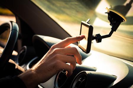 positioning: man  adjusting  gps in car closeup Stock Photo