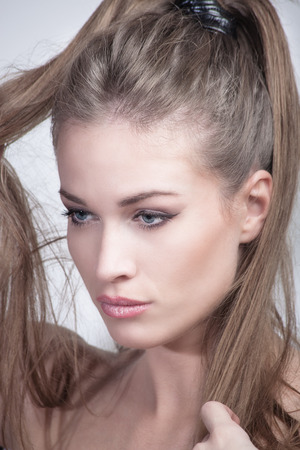 ponytail: young woman with ponytail beauty portrait studio shot closeup